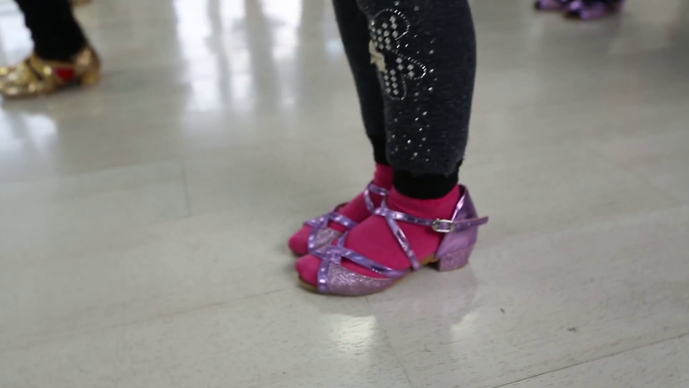 Kids wearing dance shoes in a dance group class