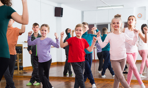 A group of smiling children in a dance class