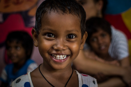 Laxmi, 2.  The youngest girl in slum school. However already knows how to count to 20 and all the alfabet letters in english.