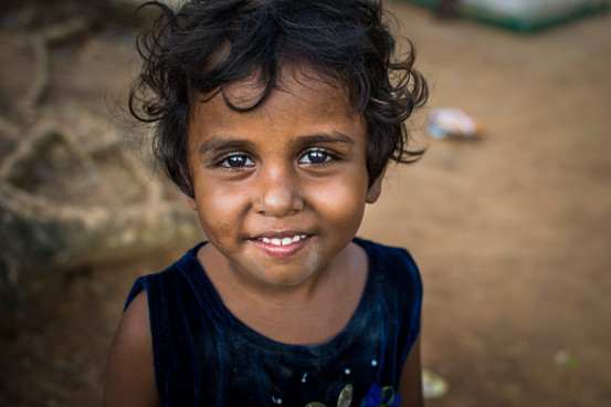 One of the young girls from slum area.  Never attended any school.