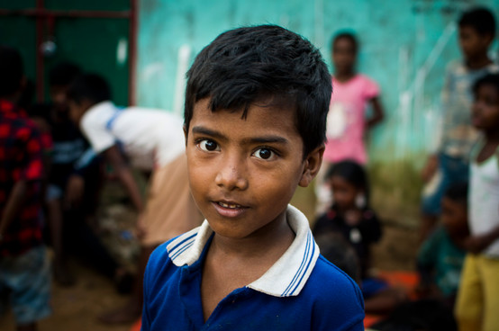 Boy from slum area. Never attended any school.