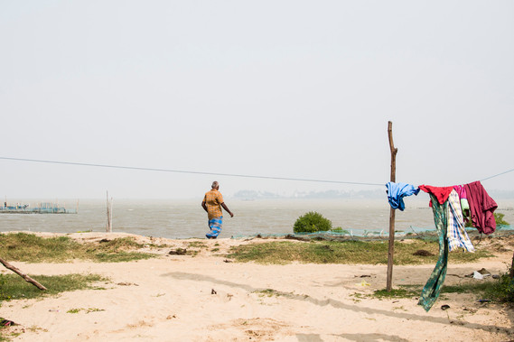 Fisherman heading towards his boat.