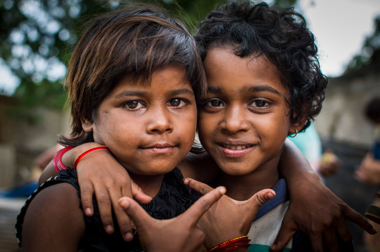 Sanya (on the right) with her friend. Sanya is 8 and is an irreverent smart girl.  Attends slum school frequently.