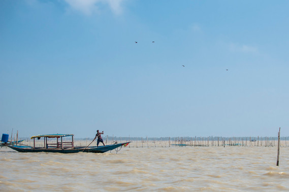 Fisherman on his boat. After cyclone, many boats were damaged, leaving hundreds of fisherman without their incomes.
