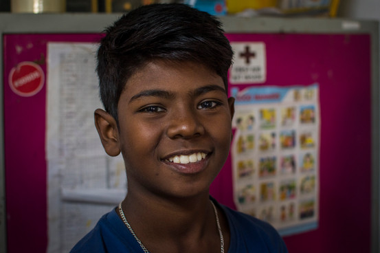 Siba, 12. One of the few kids that living in slum area attends government school. A bright young man with many skills and a kind little heart. Loves dancing and basketball.