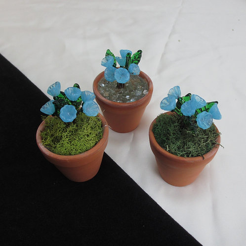 Mini Flower Pot with Bright Turquoise Flowers