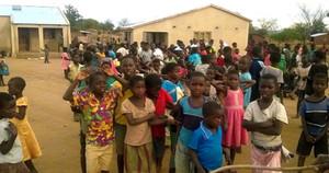 Orphanage children outside girl's dormitories
