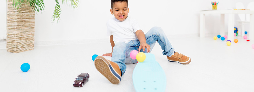 young-boy-playing-with-skateboard.jpg