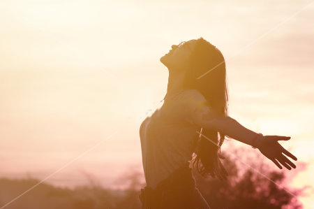 stock-photo-young-woman-relaxing-in-summer-sunset-sky-outdoor-people-freedom-style-430795531