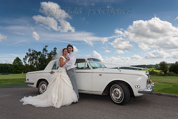 bride, groom and wedding car.jpg