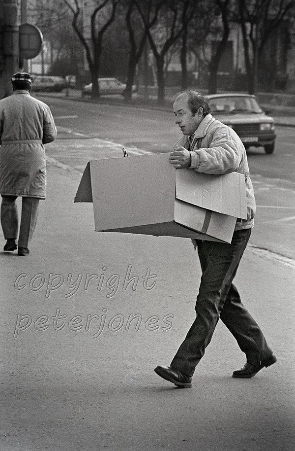 slovak man carrying box.jpg