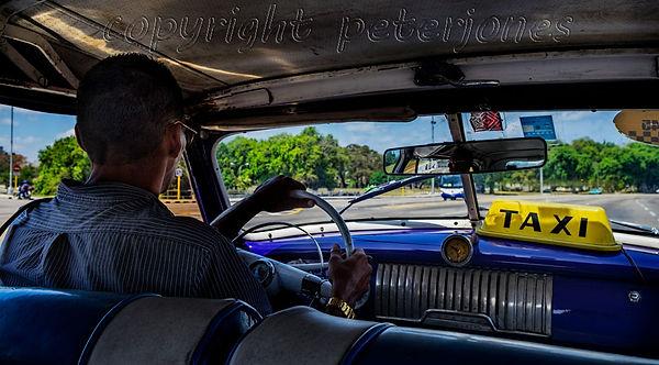 cuba american classic car driver.jpg