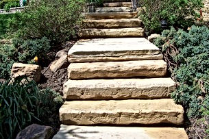 Steps made of Wallstone - Artisan Stone Products Springfield IL call 217-697-8433 or visit our beautifully landscaped outdoor showroom at 2475 Peerless Mine Road,  Springfield Illinois 62702.