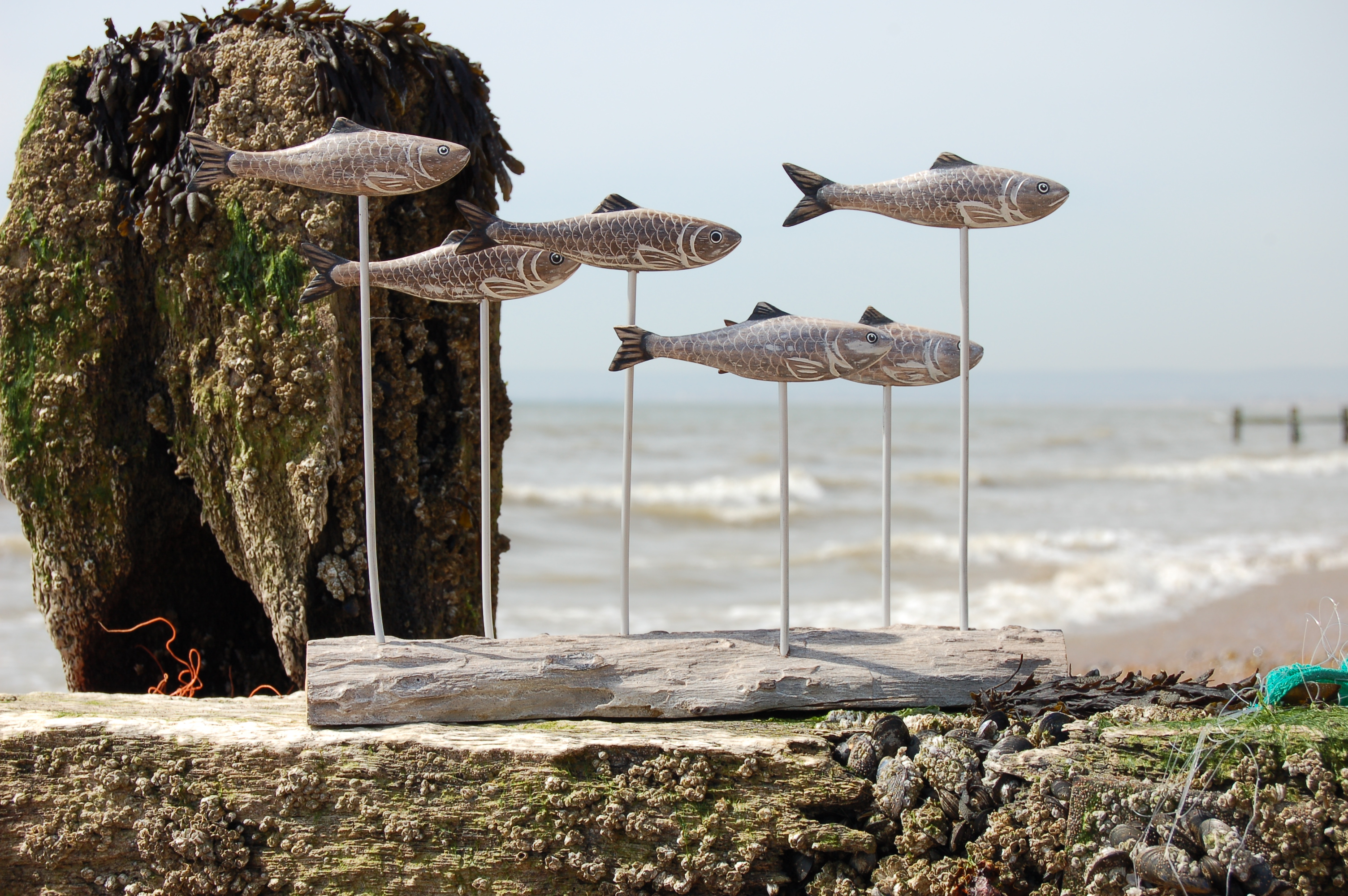 HAND CARVED HERRING SHOAL