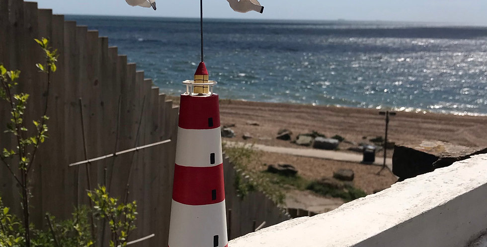 LITTLE RED & WHITE STIPED LIGHTHOUSE