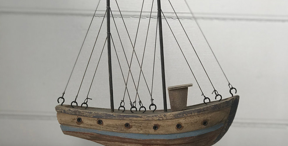 RUSTIC WOODEN TUG BOAT ON STAND