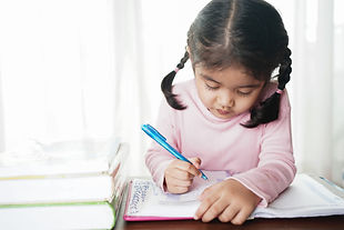 Asian student child girl writing on the