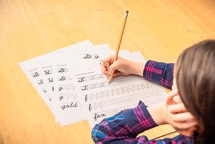 Child practicing cursive writing..jpg