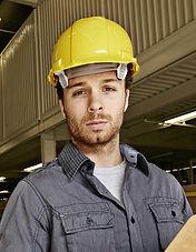 Arbetare i en fabrik