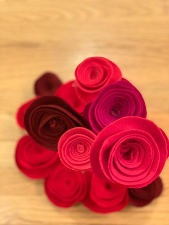Photo of felt roses in various shades of red