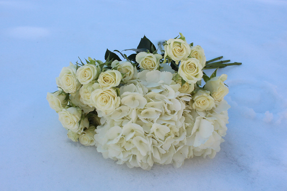 white hydrangea and sprit roses