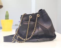 Black leather purse with gold chain