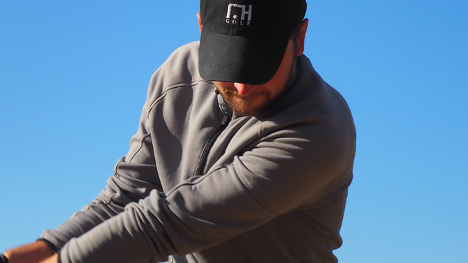 Should your shoulders be closed or open at impact in the golf swing?
