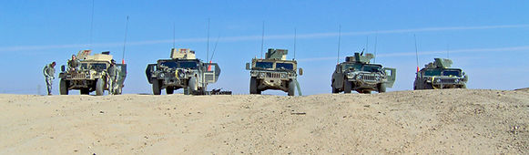 Army uparmored humvees in Iraq desert from the 187th Infantry Regiment