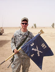 author Ryan A. Conklin with 3/187th Infantry Regiment, Company A, guidon in Iraq