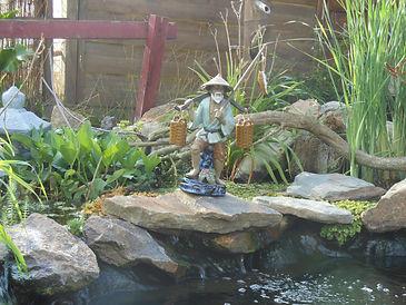 Miniac-Koïs conception et réalisation de cascade et lagunage pour bassin de jardin