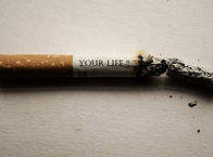 Canva - Burning Cigarrette on White Back
