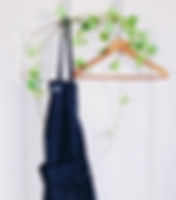 House apron with a wooden hanger for guest