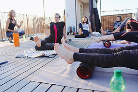foam rolling calves with instructor