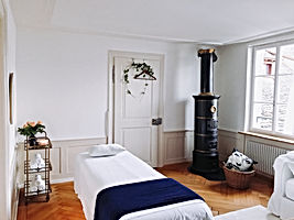 nicely decorated room massage with chimenea