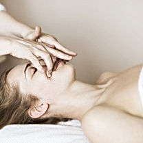 Relaxed woman having a manual and anti-aging facial massage