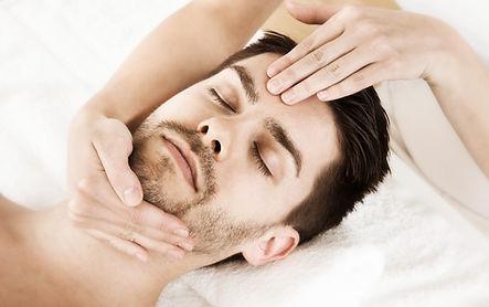 man with a beard having a relaxing manual massage