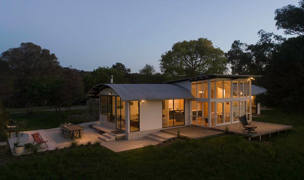 Farmhouse at dusk.