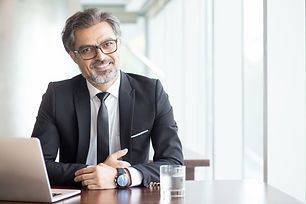 cheerful-businessman-eyeglasses-office_1