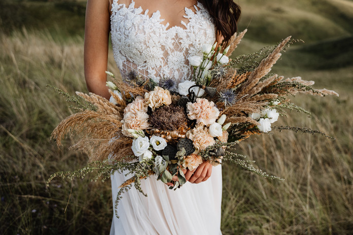 wedding bouquet of the bride, boho style, outdoor, dry flowers.jpg