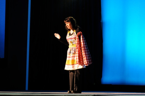 Deb performs a monologue for a pharmaceutical company as part of a general session.