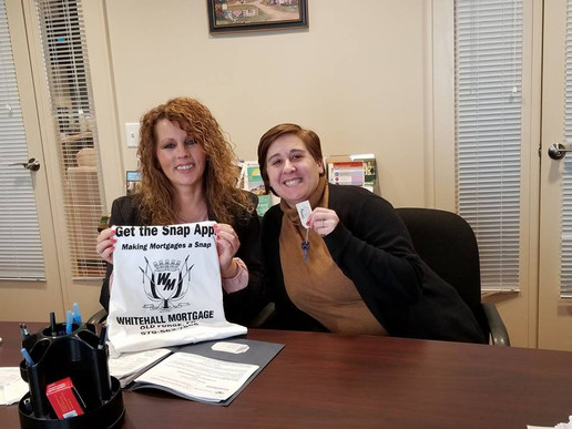 New homeowner Carrie with realtor Michele Hopkins
