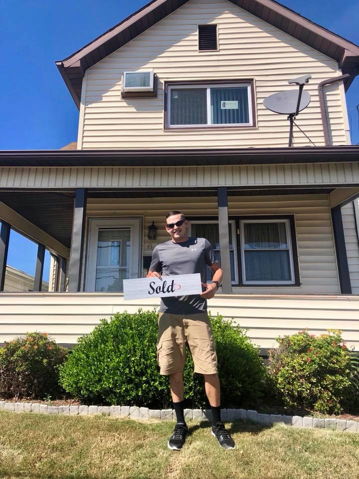 Shawn Stone and his new home thanks to realtor Jesicca Skoloda