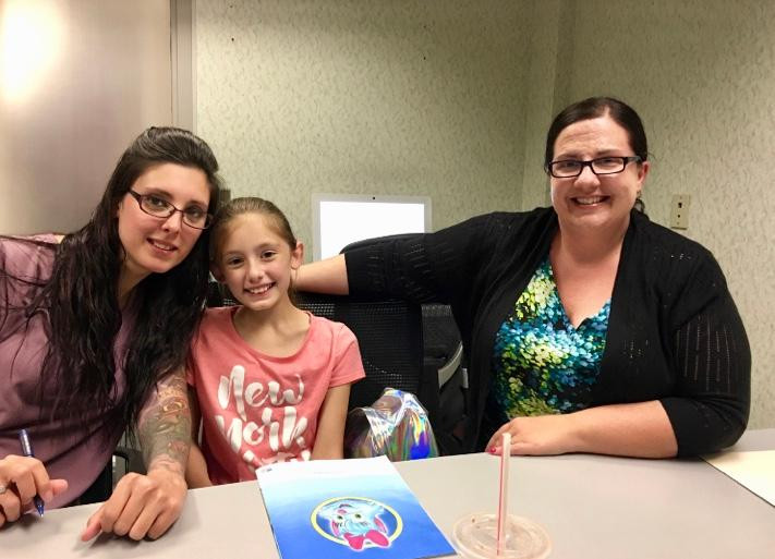 Karrie Spencer with her daughter and rea