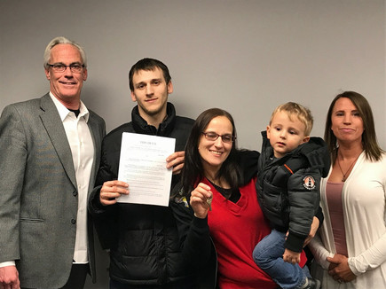 Melissa Blythe and family with realtor C