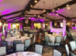 wedding reception room with up-lights