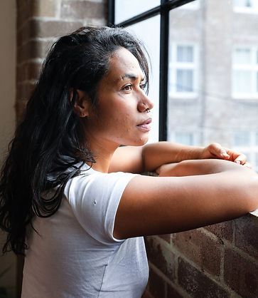 Canva - Woman Looking Out Window.jpg