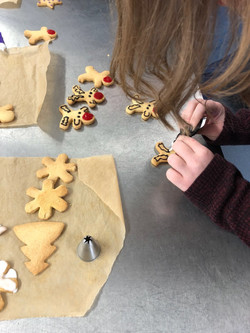 Carefully icing reindeer biscuits