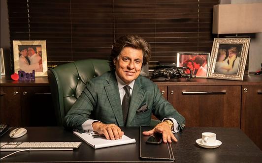 Tej Kohli at desk.png