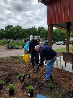 Robert and Renee preparing plantings