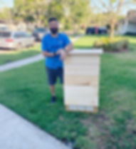 Victor Castellano with the bat house he